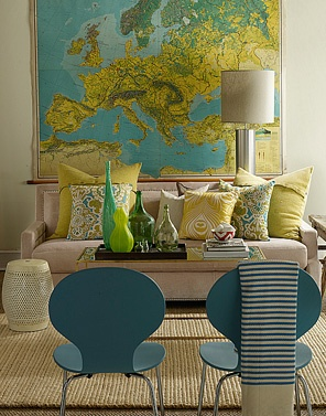 Who said you have to paint the walls?  Bring colour into your room with furniture, art or maps in this case and decorator items.  Image from elementsofstyle.blog.com