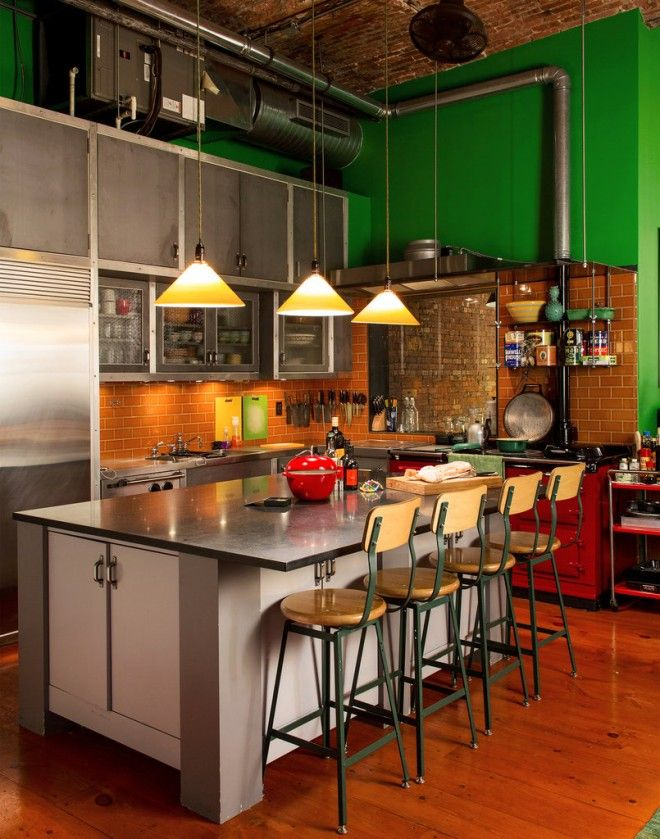 A touch of primary green complimentary to the floor boards makes for a dramatic but welcoming kitchen.  Image from loftenberg.com