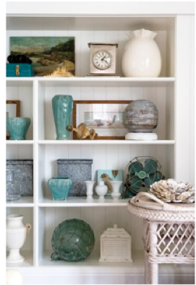 You can style your bookshelf in a soft colour palette as pictured here.